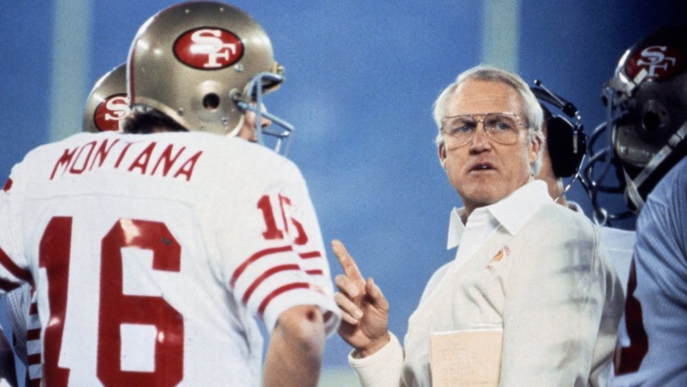 Photo of Joe Montana (L) and Bill Walsh (R) discussing strategy mid-game via the  NFL