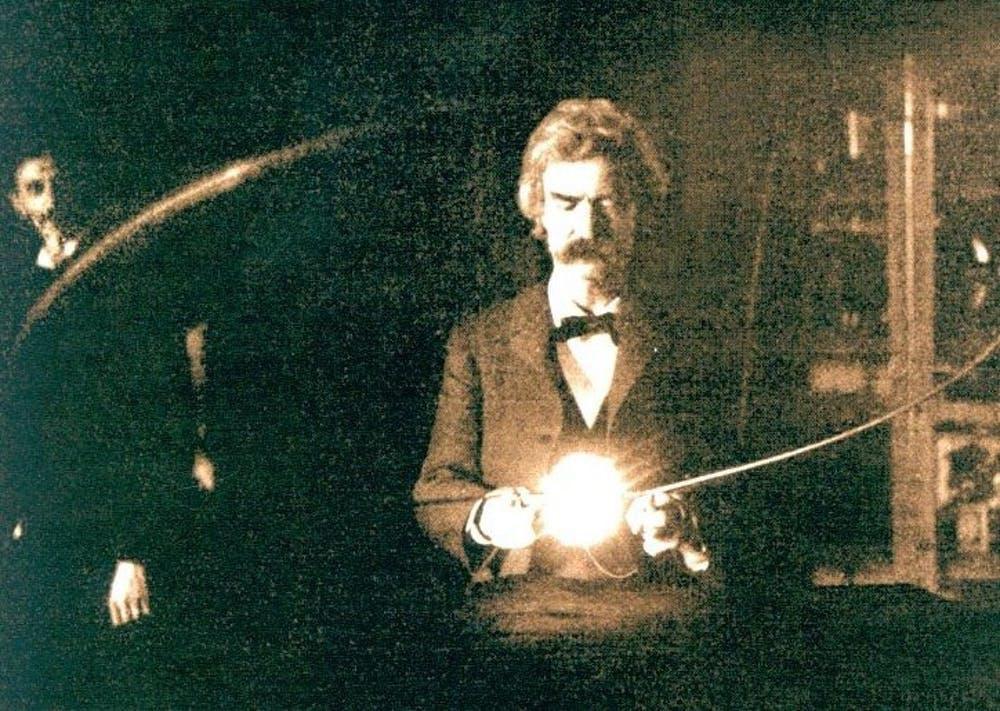 Photo of Mark Twain, a good friend of Nikola Tesla, holding Tesla's experimental vacuum lamp in 1894