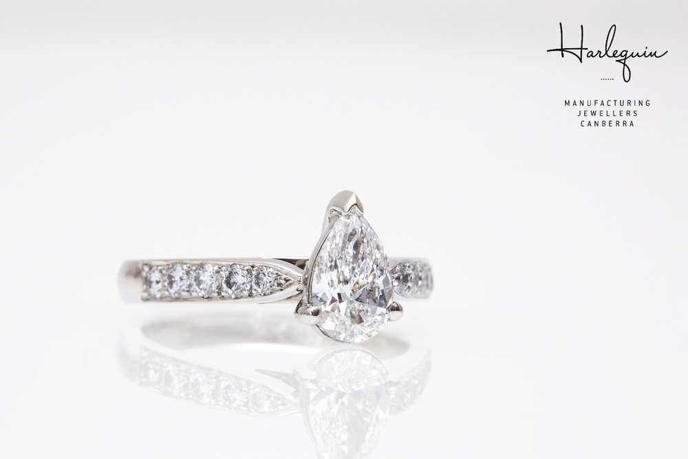Pear shape diamond engagement ring with small round brilliant cut diamonds - Harlequin Jewellers Canberra