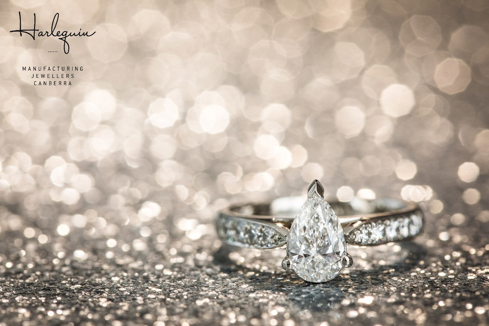 Pear shaped diamond engagement ring with small round brilliant cut diamonds - Harlequin Jewellers Canberra