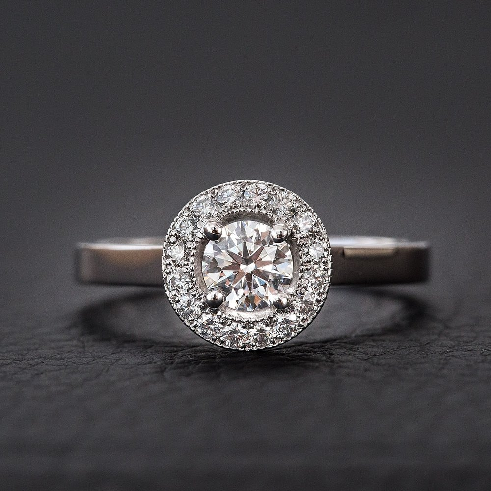 Round brilliant cut diamond engagement ring with round milgrain halo Harlequin Jewellers Canberra