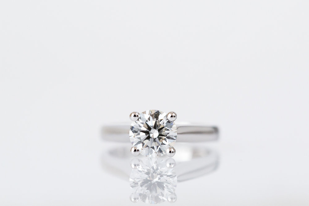 Four claw round diamond engagement ring.