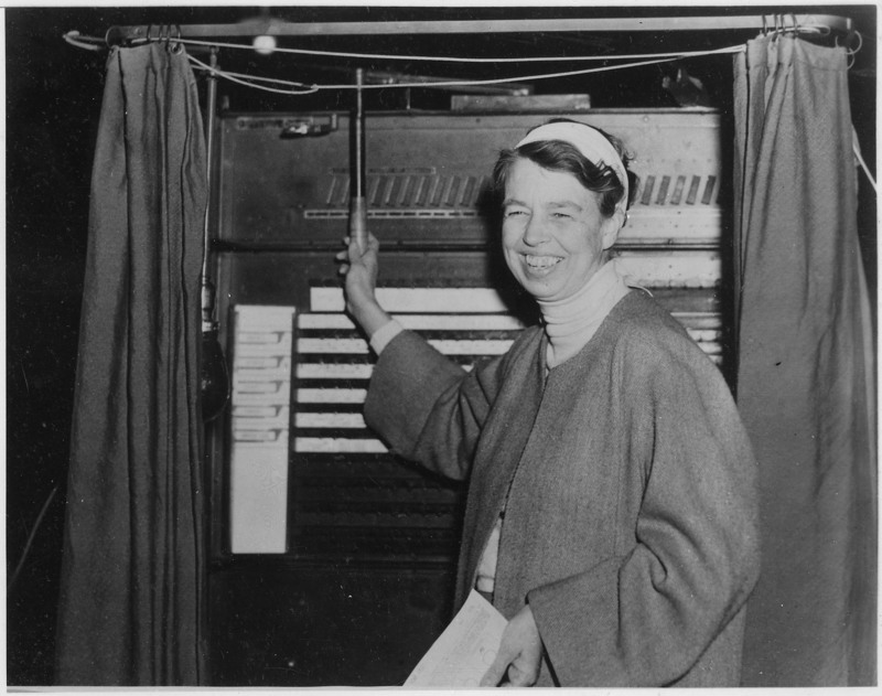 Ah, those big voting booths with the curtains, the old-timey buttons, and the big levers. Well, apparently they didn't change much between 1936 when Eleanor Roosevelt is pictured using the machine and when I went with my parents to vote in the 1980's...