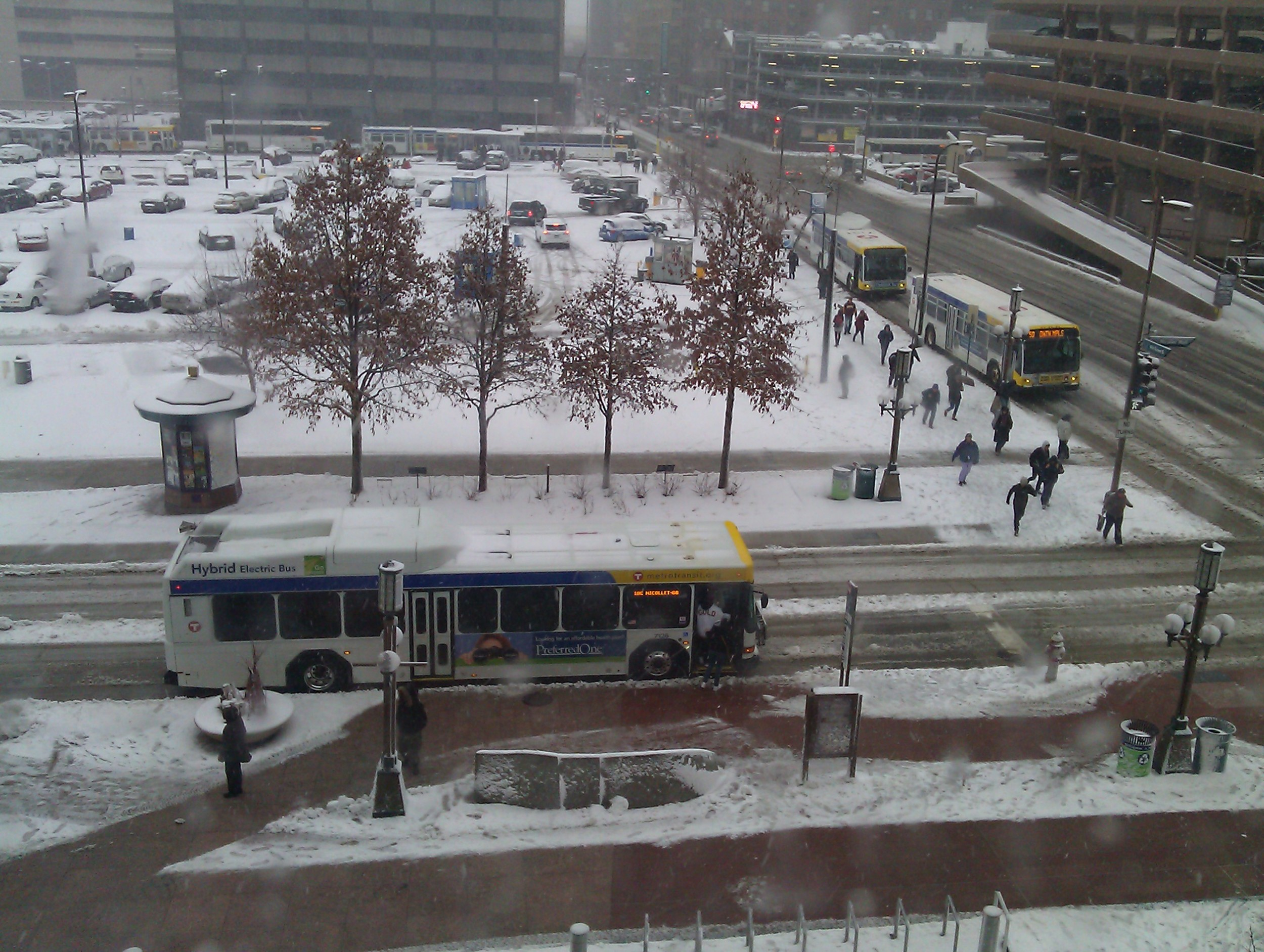 Local bus on Nicollet Mall (bottom) and 4 St (right); express buses on Marquette (background).