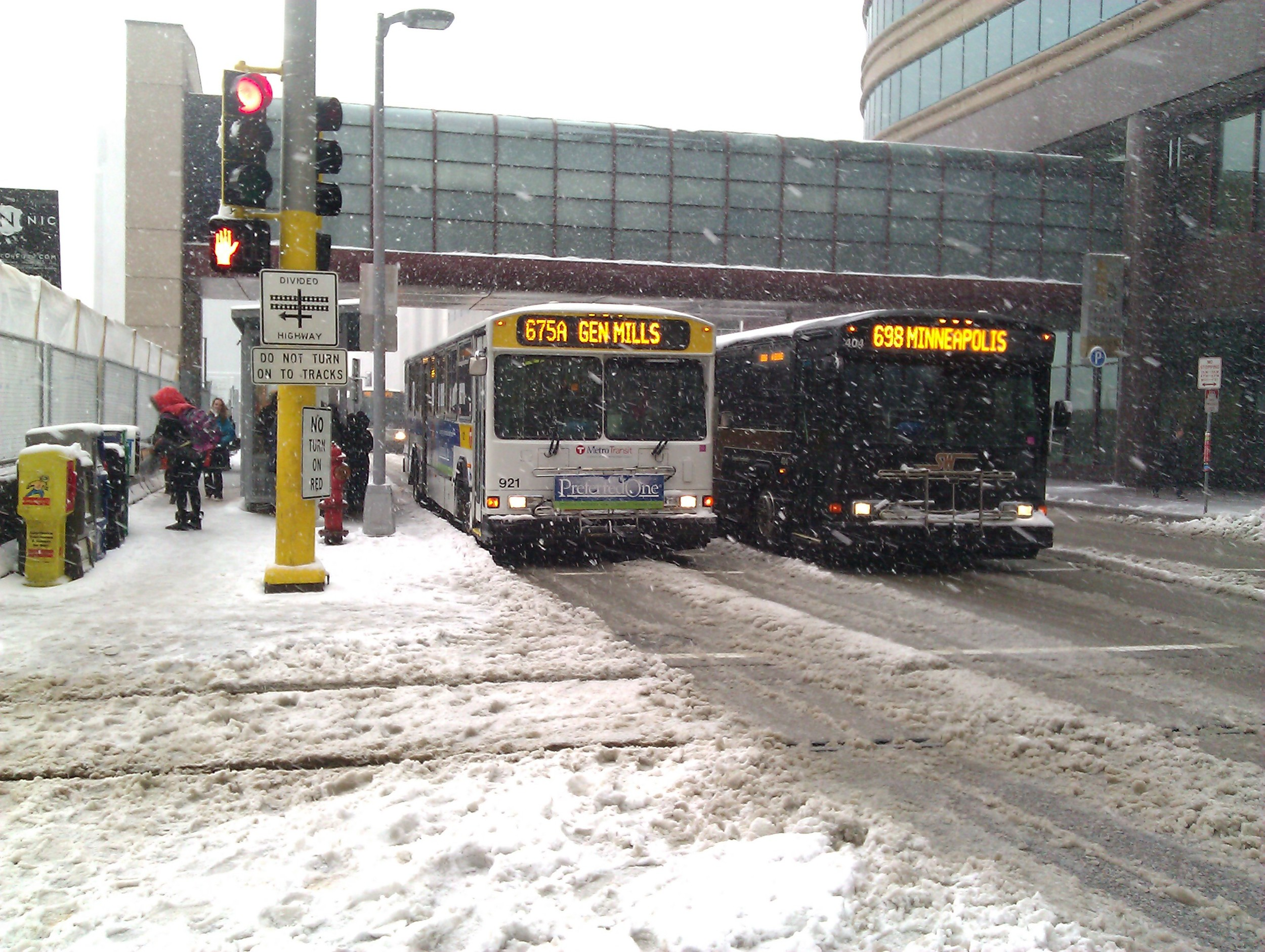 Express buses brave the late April snow.