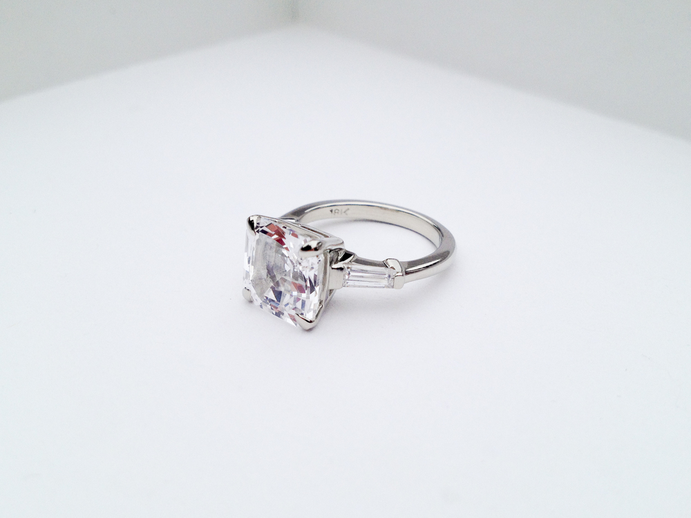 ADELE Engagement Ring:  ethically-sourced sapphire Asscher-cut, baguette diamonds, and 18k white gold