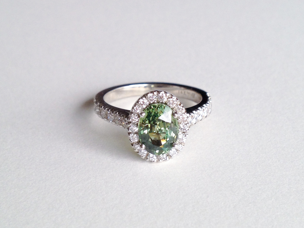 CLAIRE Engagement Ring:  ethically-sourced green sapphire oval-cut, pavé diamonds, 18k white gold.