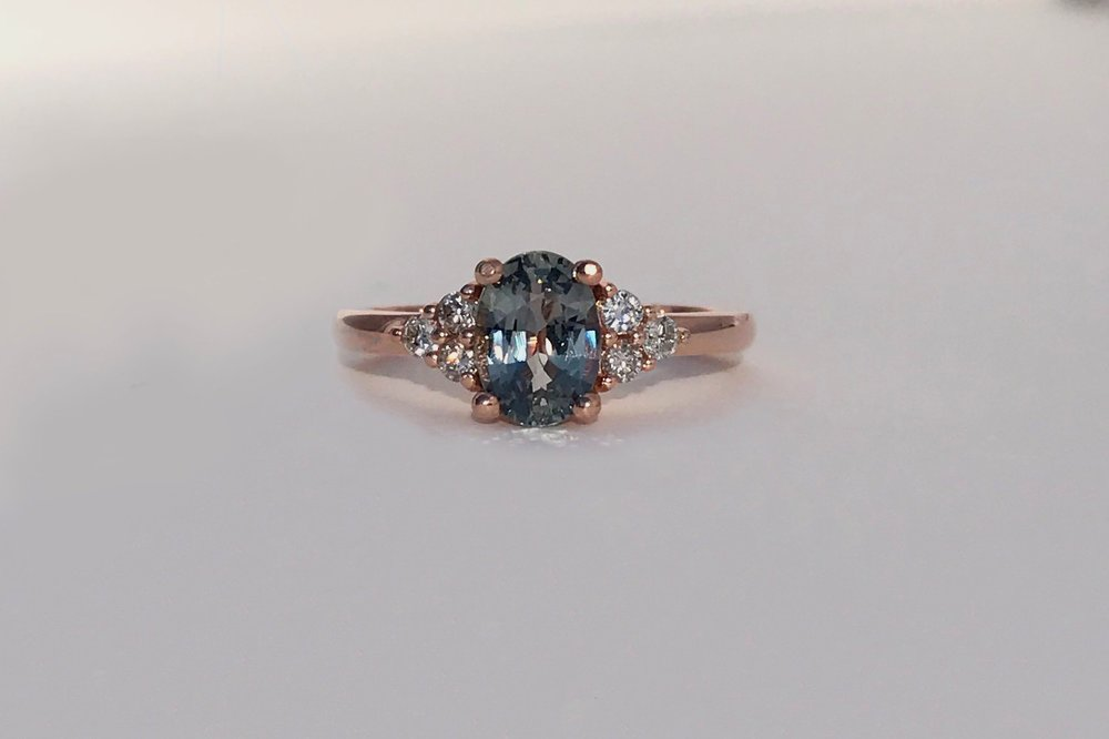 KAIRA Engagement Ring:  ethically-sourced, oval purple-grey sapphire, white diamond melee, 14k rose gold.