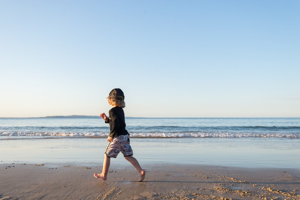 Mr 3 running on Noosa beach