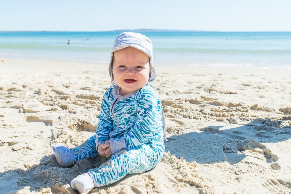Baby Beau playing in the sand on Noosa Beach