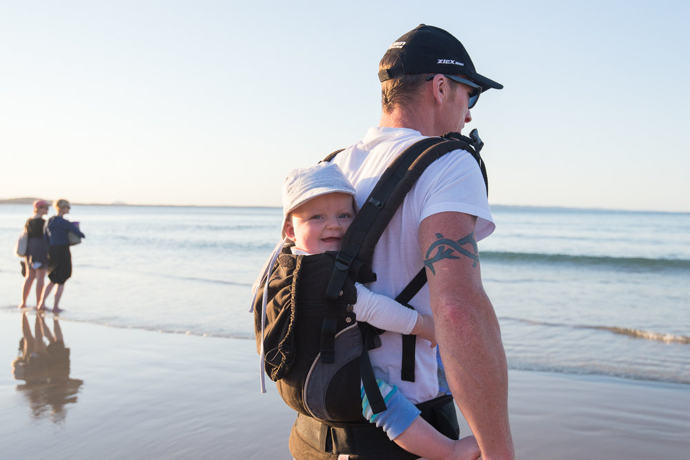 In the back carrier on Noosa beach