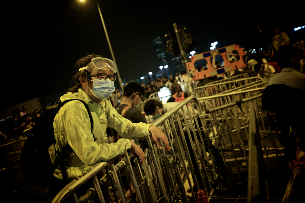 A protester takes a rest after securing Lung Wo Road.