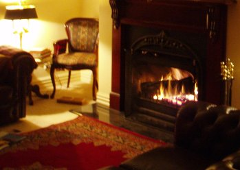 Traditional open fireplace to recount the day's adventures by...
