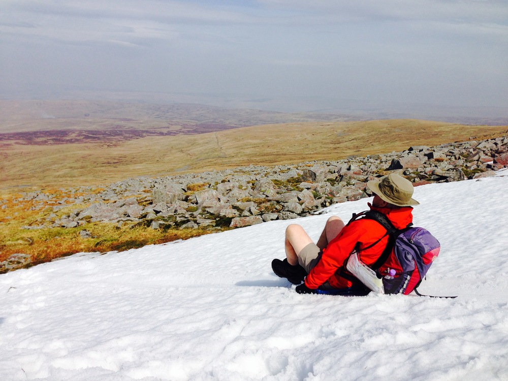 Harry sledding down Cross Fell