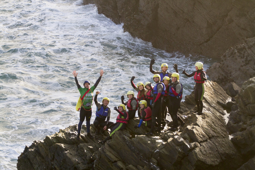 Nervous smiles before leaping into the bracing sea (Image: Warrick Murphy / Newquay Activity Centre)