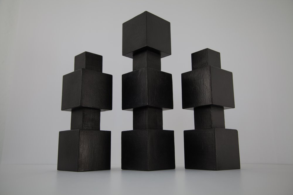 There's a Block in the Void (Totem Group) , 2017, gesso and acrylic paint on wood, 14.5 x 3 x 3 inches (center), 11 x 3 x 3 inches (left and right).