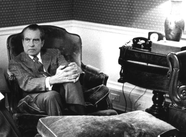Nixon in the Lincoln Sitting Room in the White House residence. The phone pictured was on a recorded line.