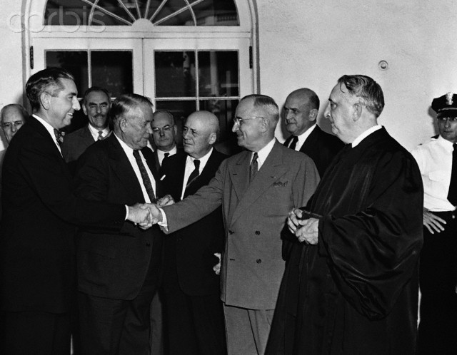 Truman congratulates Tom Clark.