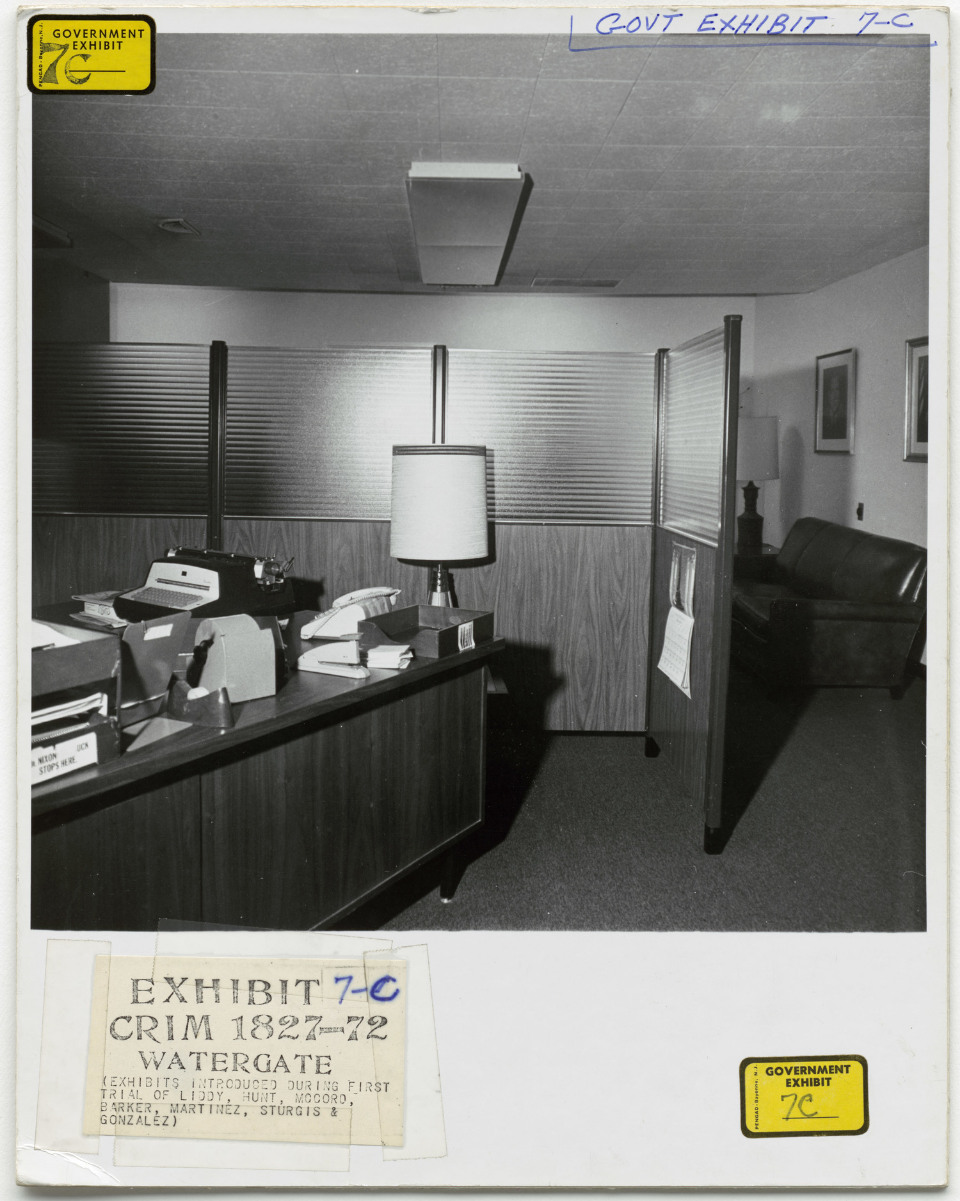 A photo from the Watergate Burglars' criminal trial in January 1973.  This is where the burglars were found by police, hiding behind this secretary's desk outside chairman Larry O'Brien's office in the Democratic National Committee's headquarters in the Watergate complex.