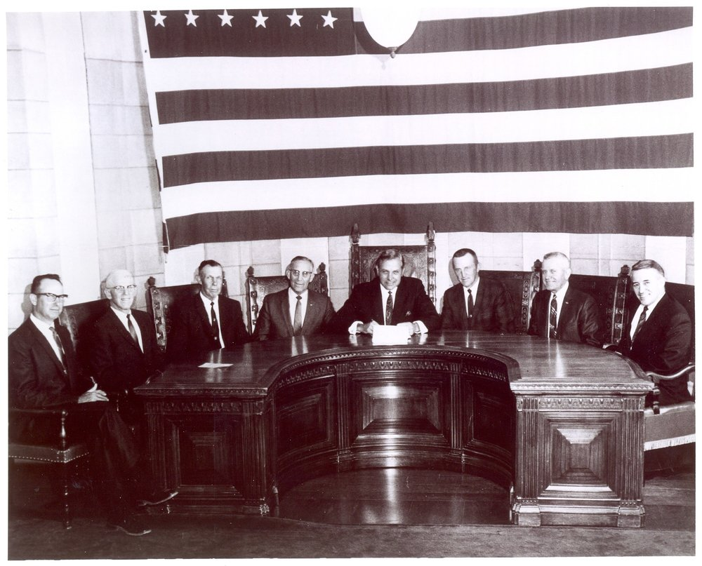 The signing of the bill to create NRDs in Nebraska in 1972 - Those instrumental in the bill's passage were, from left:  Harold Siek, Herman Link, Chet Ellis, Senator Maurice Kremer, Governor Norbert Thiemann, Warren Patefield, Milton Fricke, and Warren Fairchild.  Nebraska's NRDs began when the legislature consolidated 154 watershed districts and conservation districts into 24 local watershed-based Natural Resources Districts.