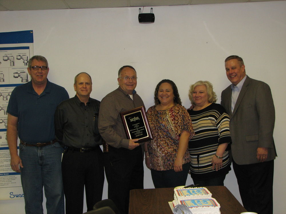 Our Safety Team, receiving an award from a representative from the state of Oklahoma