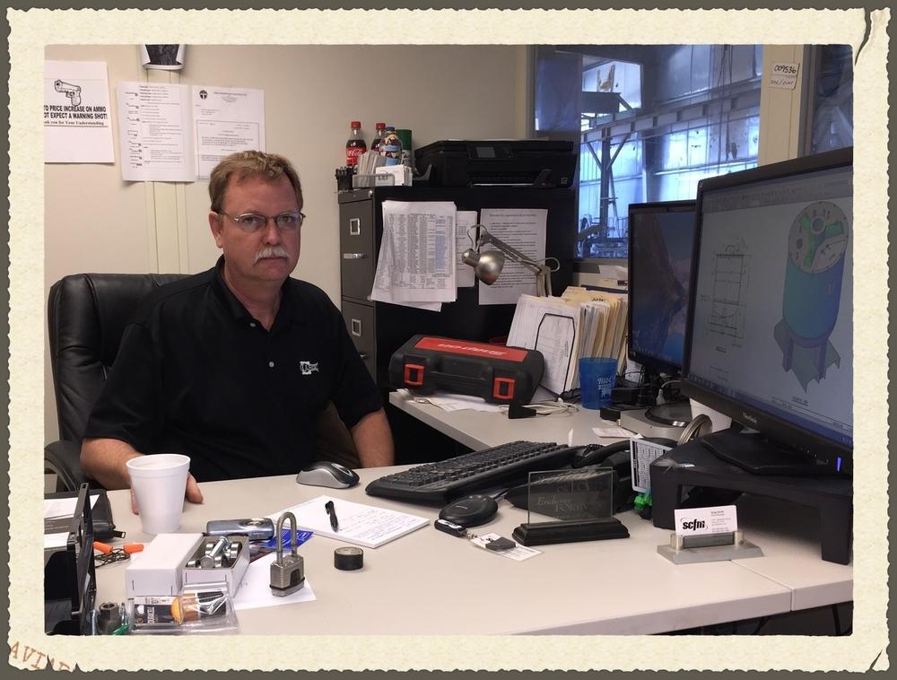 Greg @ Desk.jpg