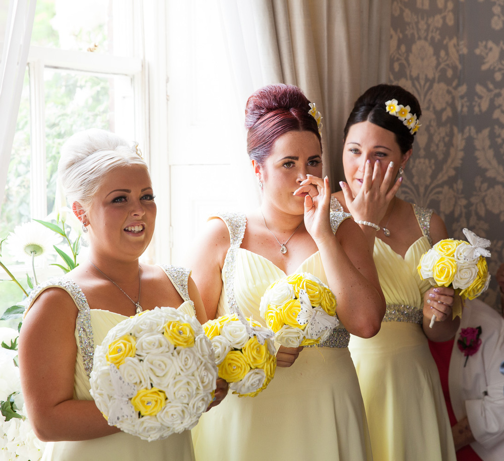 Bridesmaids weeping