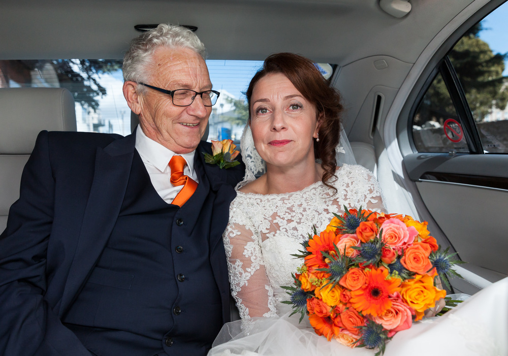 Father and bride in car
