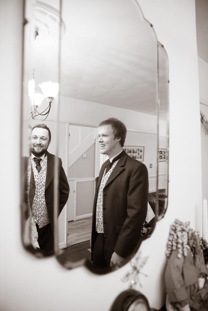Groomsmen in mirror