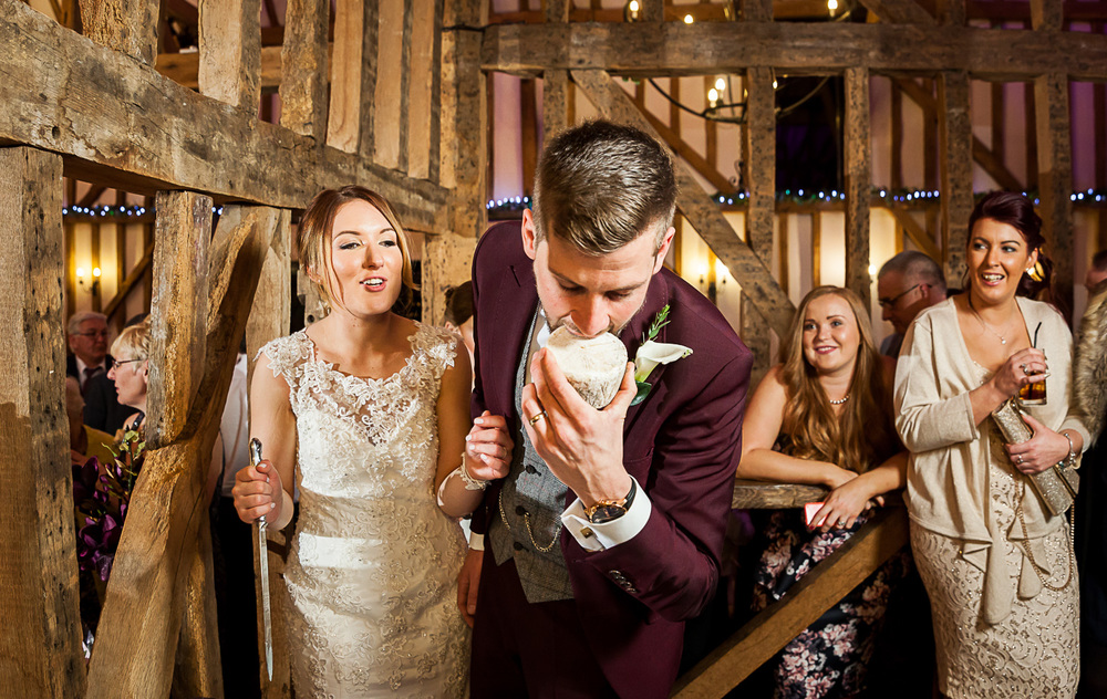 Groom pretending to eat cake