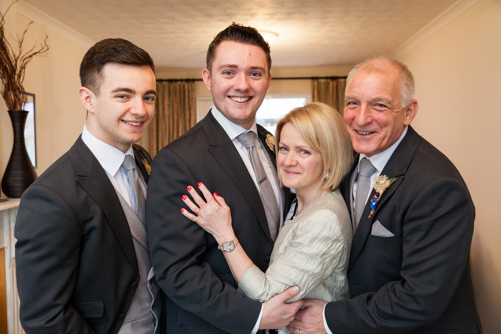 Groom with immediate family at home