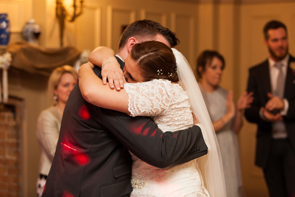 Bride and groom hug