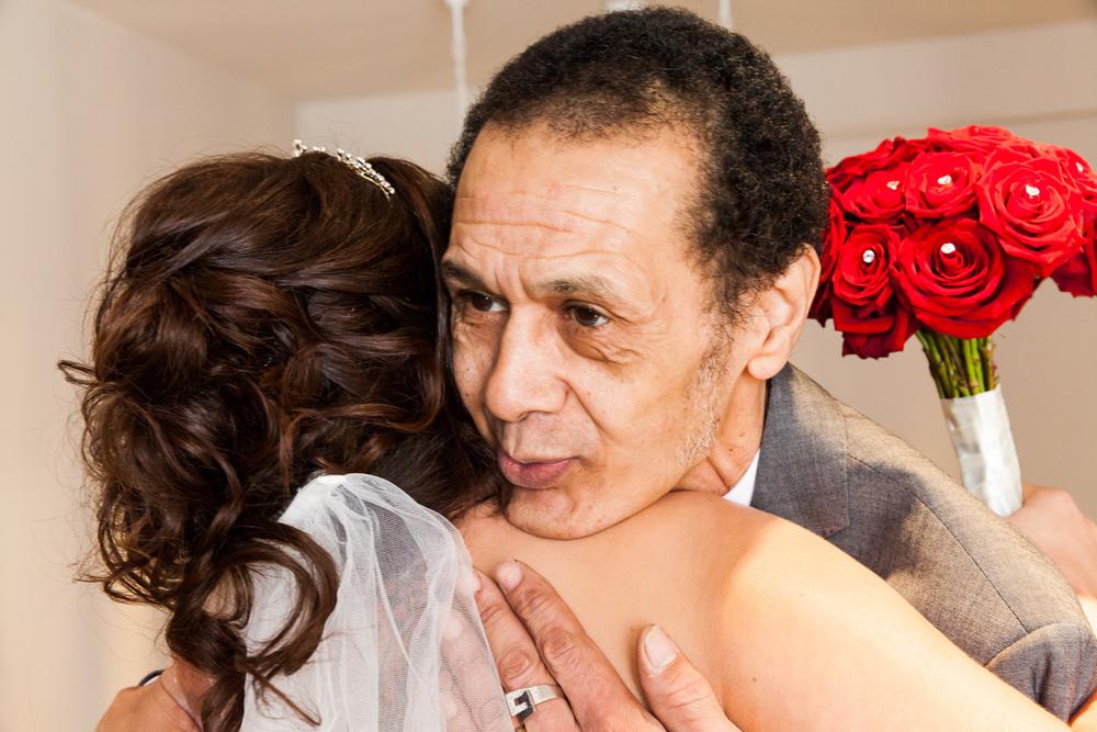 bride hugging dad