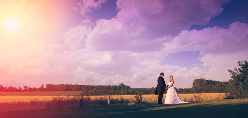 Beautiful kent landscape image with bride and groom