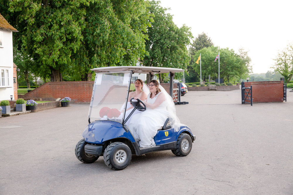 brides in golf buggy