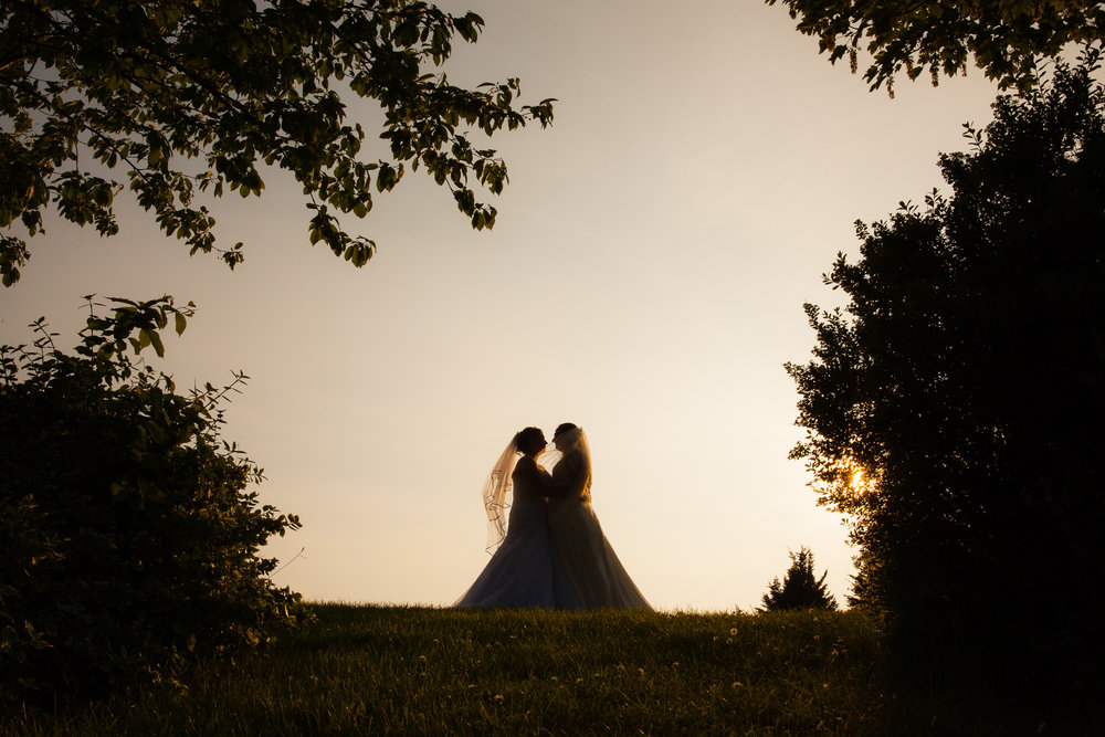 sillouette of couple on the hill
