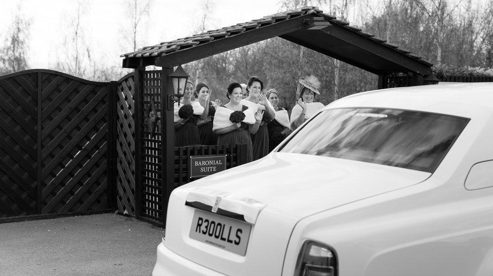 Bridesmaids waving at bride arriving
