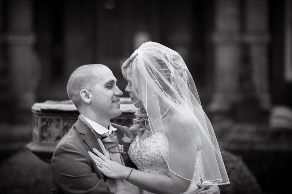 A tender moment with bride and groom