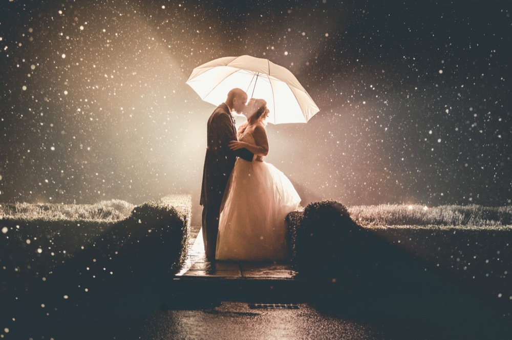 Stunning snowfall wedding shot