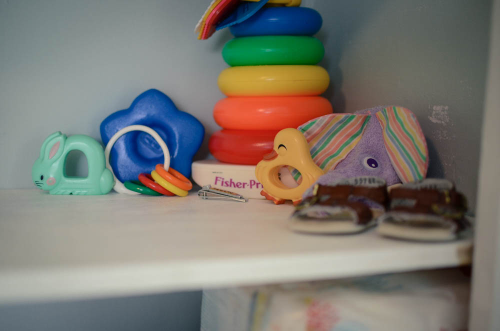 I absolutely love this little corner on the shelves! These are all items that were from when I was a little babe! So thankful my mom saved a few select items and gifted them back to me!