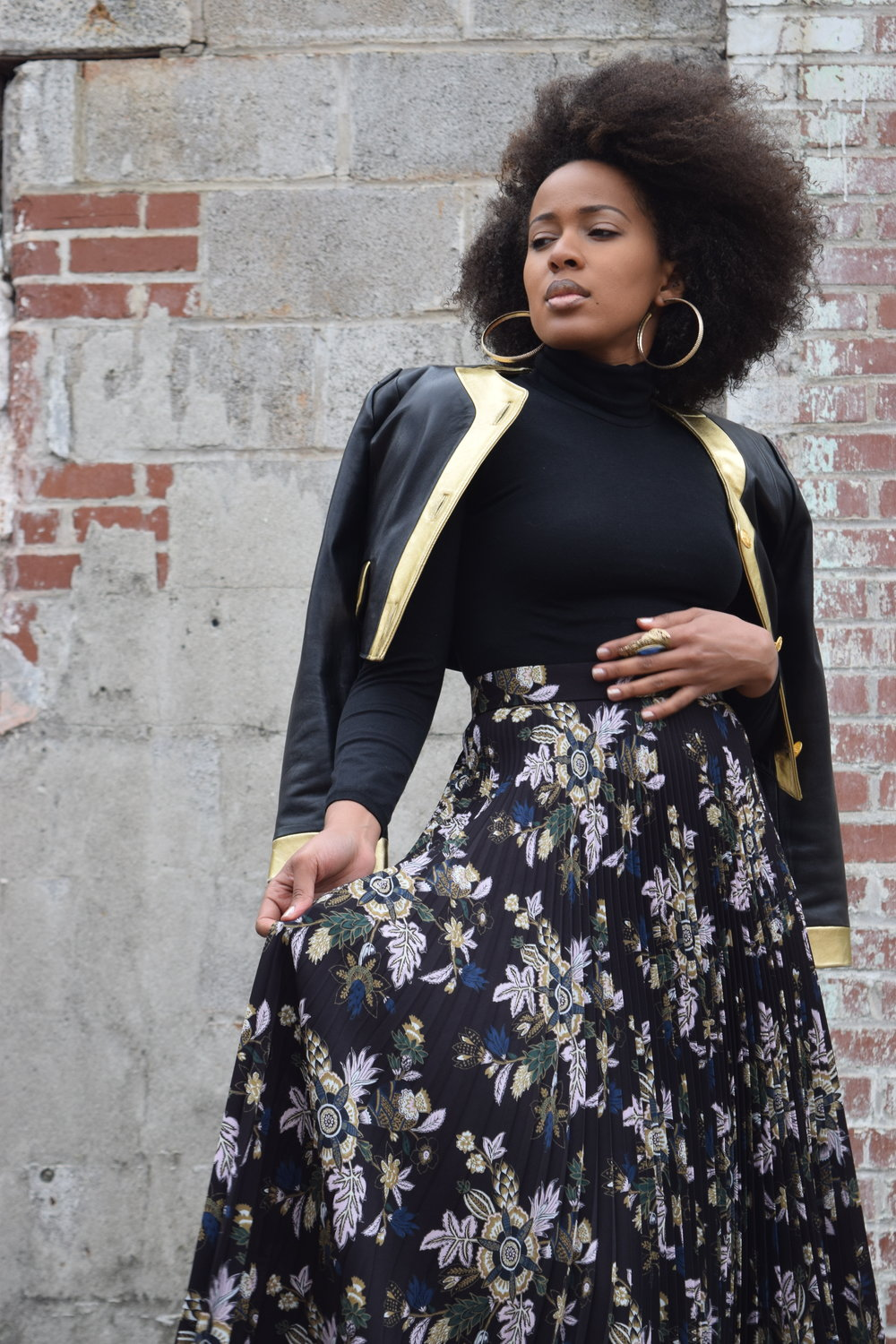 Look:  Vintage Michael Hoban for North Beach leather jacket, A.L.C 'Williams' pleated floral print skirt, Wolford bodysuit, Donald J. Pliner booties