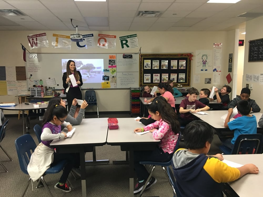 Maria Harmon uses a plan of the Colosseum in Rome to illustrate the principle of symmetry to a group of fifth-graders at Mendenhall Elementary on Jan. 13.