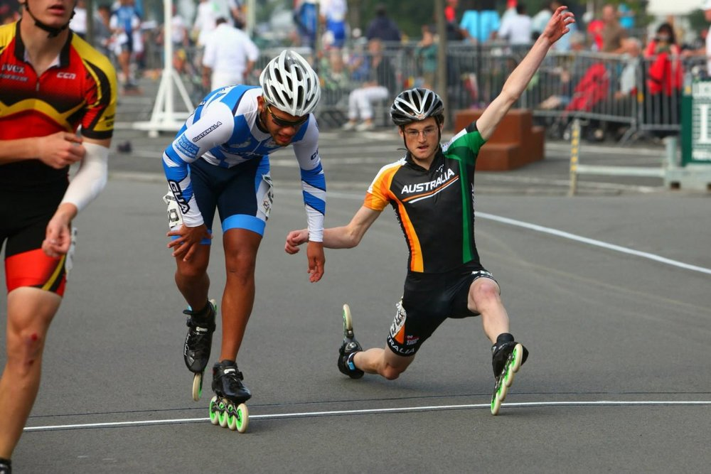 I was looking for an image of someone barely crossing the finish line, and this came up, which just had to be used for something.  I think that move he is doing is on purpose?