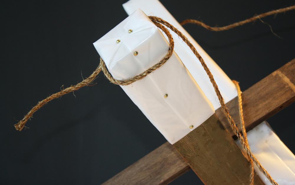 BARRICADE SCULPTURE DETAIL - visqueen, rope, wood, gold tacks