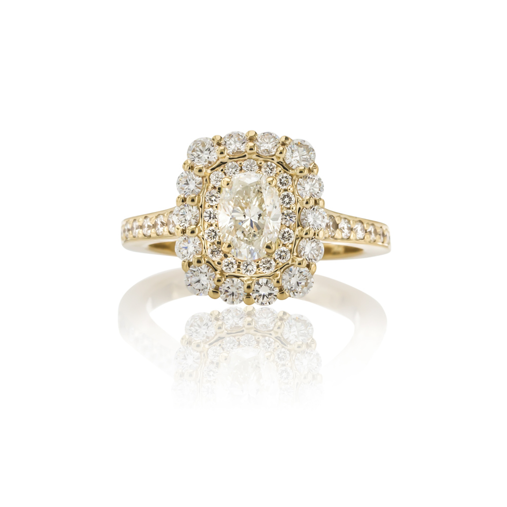 CUSTOM DOUBLE-HALO DIAMOND ENGAGEMENT SET IN 18K YELLOW GOLD.