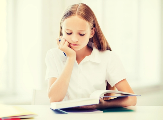 education and school concept - little student girl studying at school.jpg