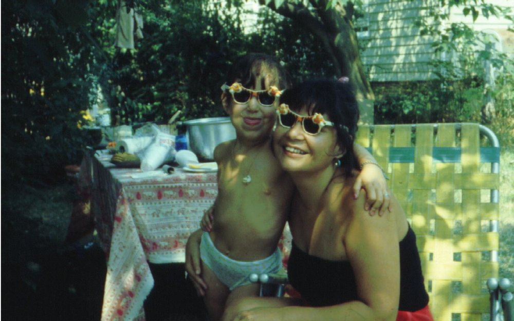 My mom and I when I was 4, with big, wild cat sunglasses