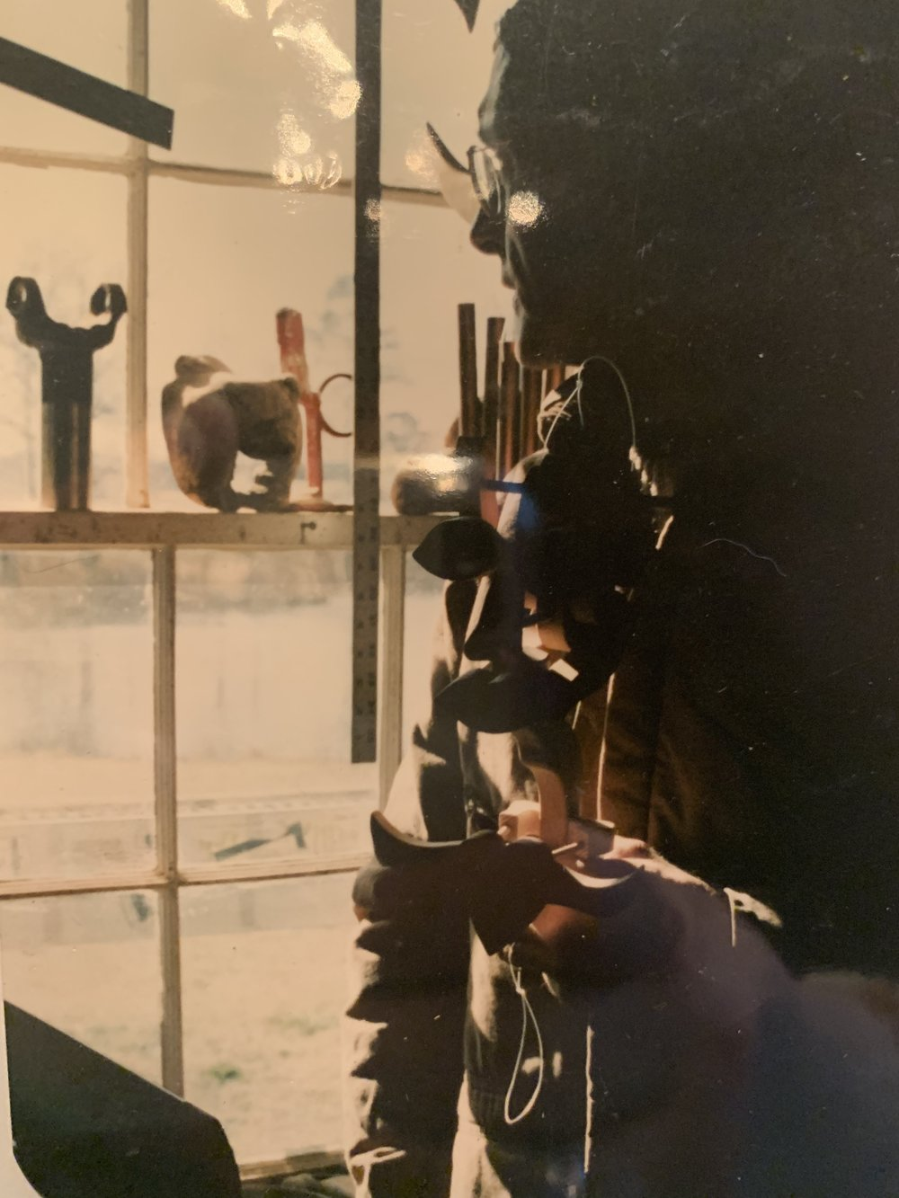 Photo of my dad with his sculptures, 1990's