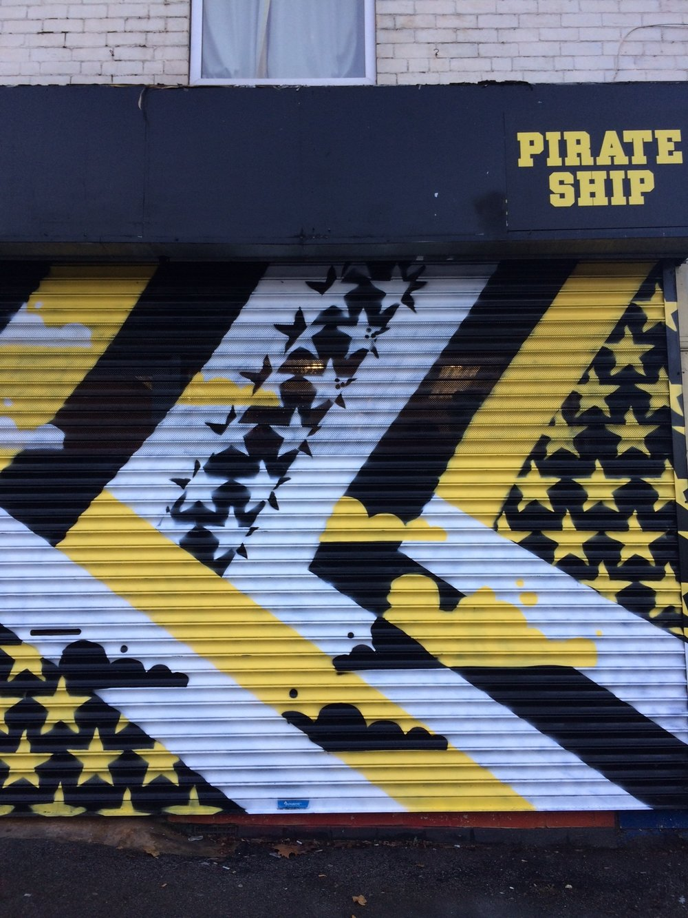 Just over the road is pirate ship which specialises in vintage sportswear og streetwear graffiti supplies their shutter is painted by mistone