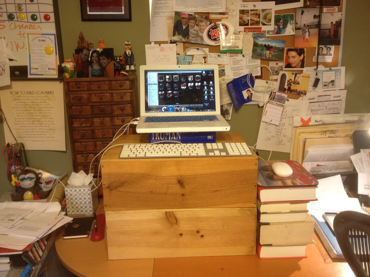 After hearing so much about standing desks , I built one out of two wine crates and a set of quaint books I don't use that much anymore: dictionaries.   I will probably need to raise the screen a little higher.